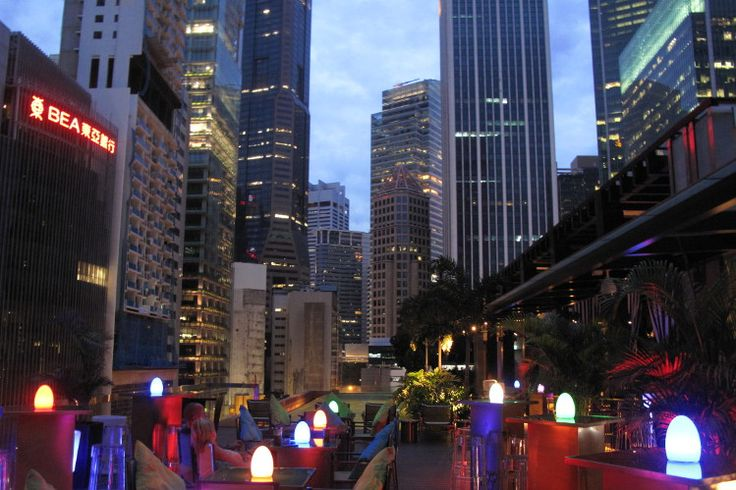 Iluminated tables with a cluster of Singapore skyscrapers in the background