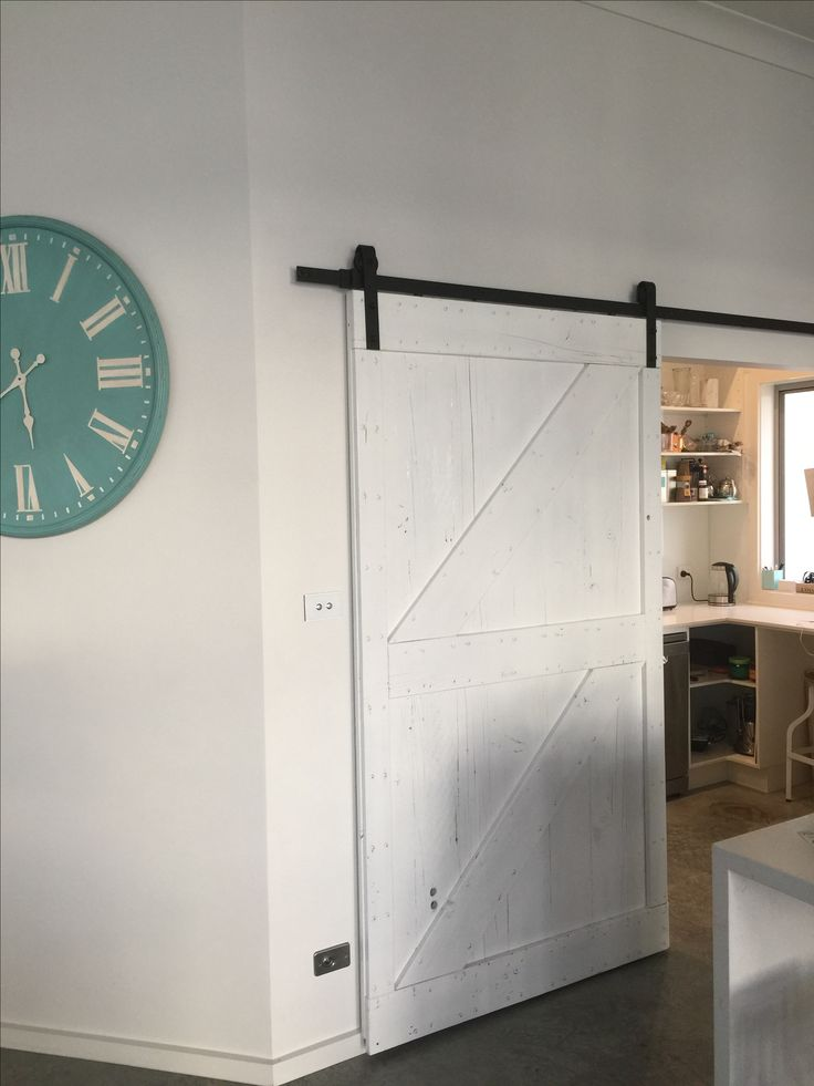 Barn doors are finally up. This one closes of Butlers pantry to hide the mess!  #barndoors #white #doors #blackandwhite