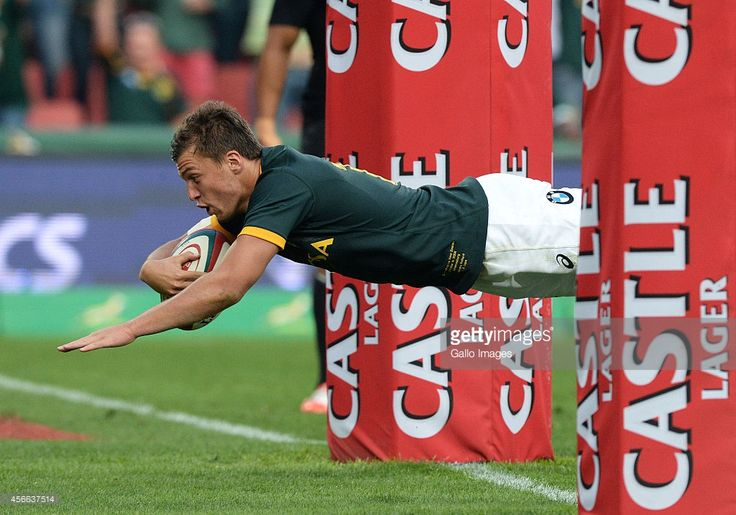 Handre Pollard of South Africa dives over for his try during The Castle Rugby Championship match between South Africa and New Zealand at Ellis Park on October 04, 2014 in Johannesburg, South Africa.