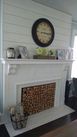 Faux stacked wood insert, mantle box with mason jars, shiplap above fireplace