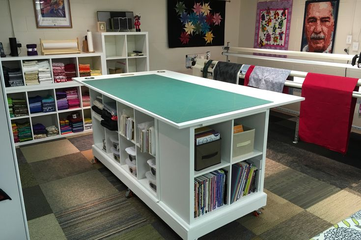 A cutting table with cup holders and built-in trash can. Love it!