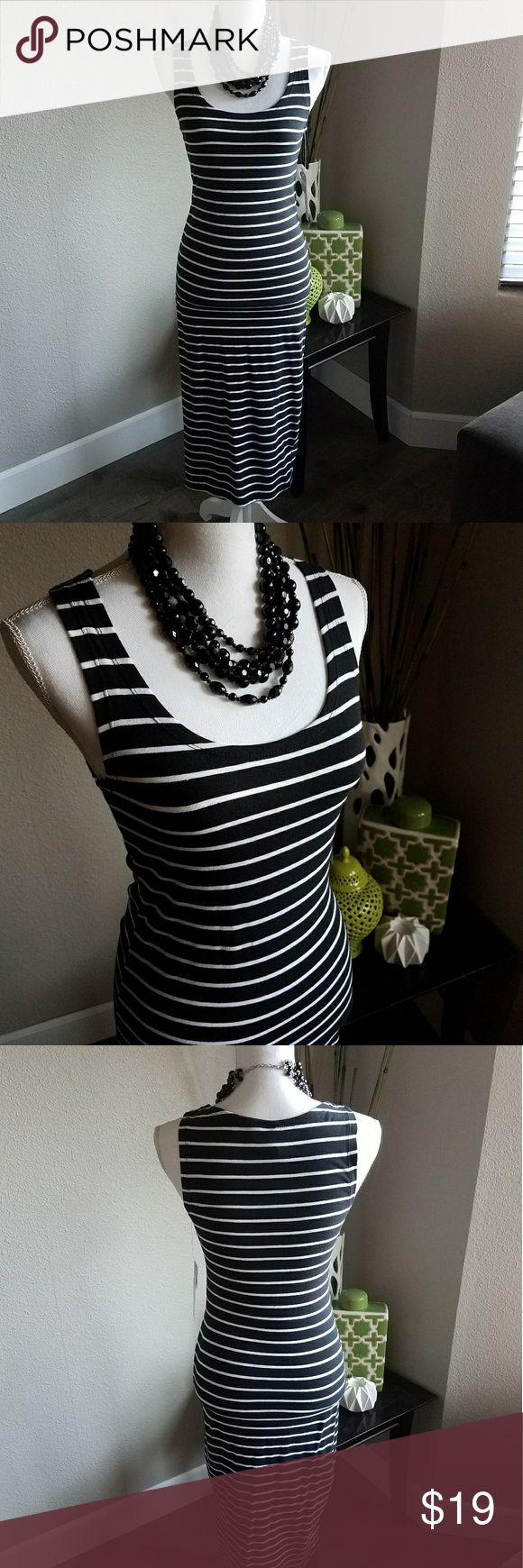 Black and white striped bodycon dress New with tags.  Black and white striped bodycon dress.   Very cute and stylish.  Perfect for this summer!  Smoke free and pet free home. Dresses