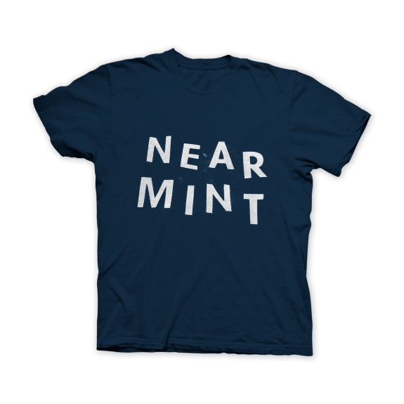 "Back in October, James designed the ""first"" Near Mint shirt which actually just featured adhesive letters from Michael's stuck onto an Old Navy white tee. We're paying homage to that design here with letters that won't fall off! This is printed on dark blue Gildan shirts with white lettering. This design was adapted by Corey Purvis and is limited to a one-time printing of 35 shirts."