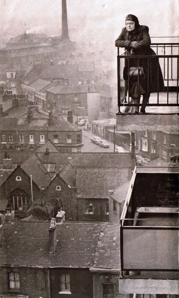 Coronation Street, Manchester 1968. High rise flats overlooking old terraced houses.