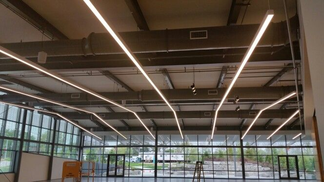 Selux linear Lighting following the pitch of the ceiling line at Woodward in Rockford, IL
