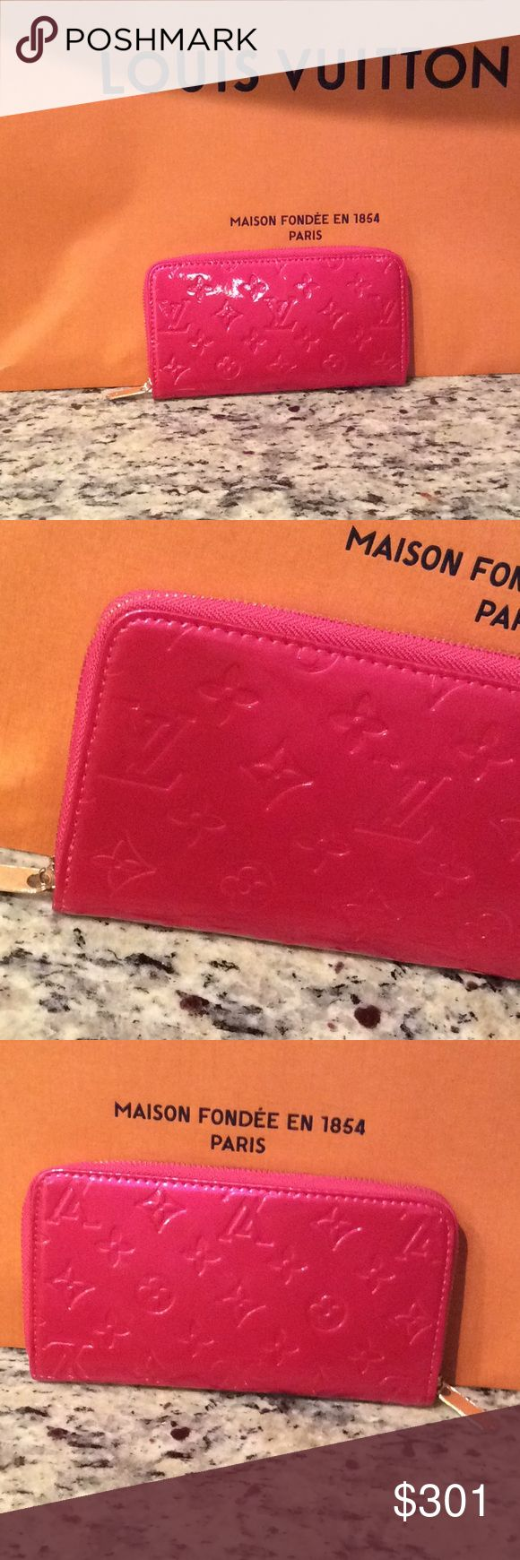Louis Vuitton full zip wallet hand purse hot pink Just make an offer All reasonable offers will be considered   This is a brand new Louis Vuitton Metallic hot pink full zip wallet with tons of card holding slots and a zipper inside for coins and cash this is a really high quality INSPIRED or NOT AUTH piece i think bc i can't find a date stamp in it so I will sell this piece at a fraction of the cost of a real. The shopping bag in the background is not sold with this purse Louis Vuitton Bags