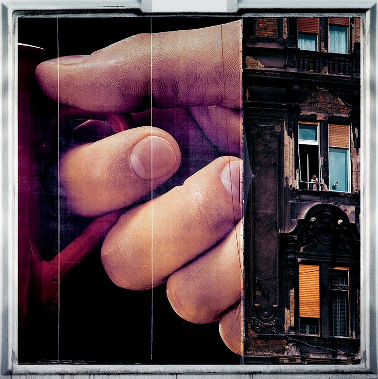 The woman, shaking her duster out her appartement window, provides the scale of the gigantic advertisement covering the adjoining building, of which that portion seen in the photograph is but a fraction. (See photo entitled `Boulevard.`) Advertising campaigns of these dimensions are now commonplace: another visual assault over which we have no direct control.