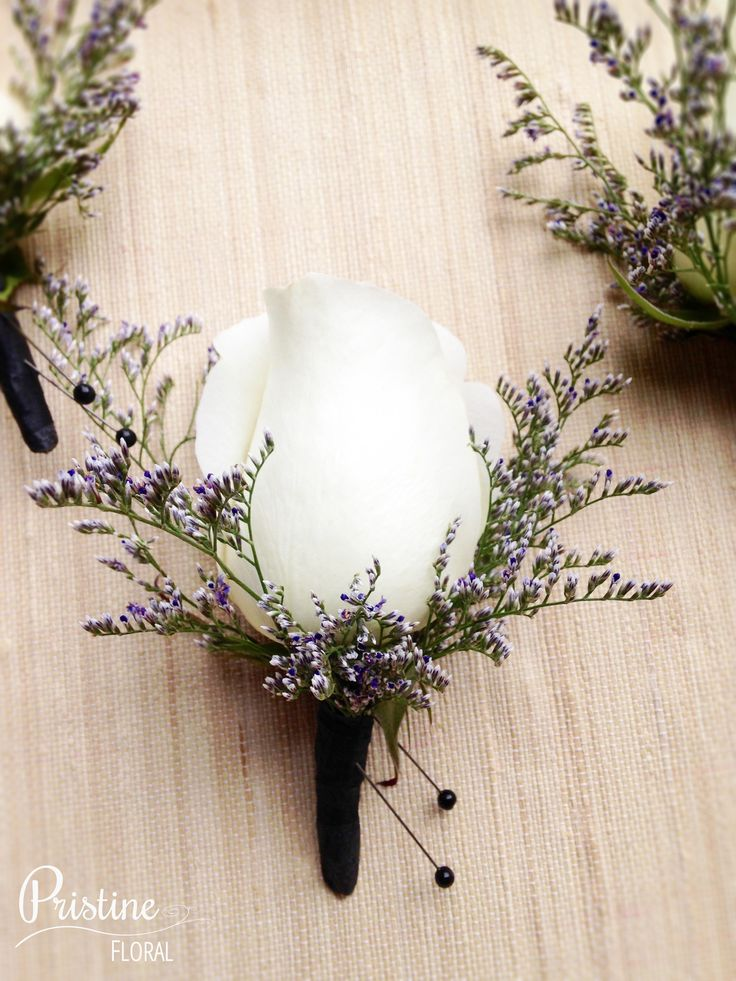 Vintage White Rose Boutonnieres finished with Purple Caspia