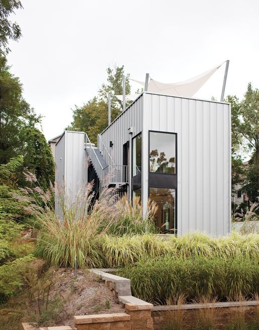 The home's metal cladding is Pac-Clad, a material typically used for roofs.  Photo by: David Robert Elliot