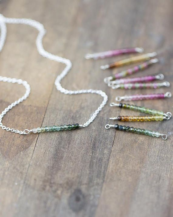 A dainty row of tiny high quality sparking tourmaline gemstones is paired with my favorite sterling silver cable chain. Choose a color: Pink & Green Multi-color, Pink, Teal Green, Forest Green, or Honey Yellow. • All components are solid sterling silver. • Gemstone bar is 0.8 inch (1 inch