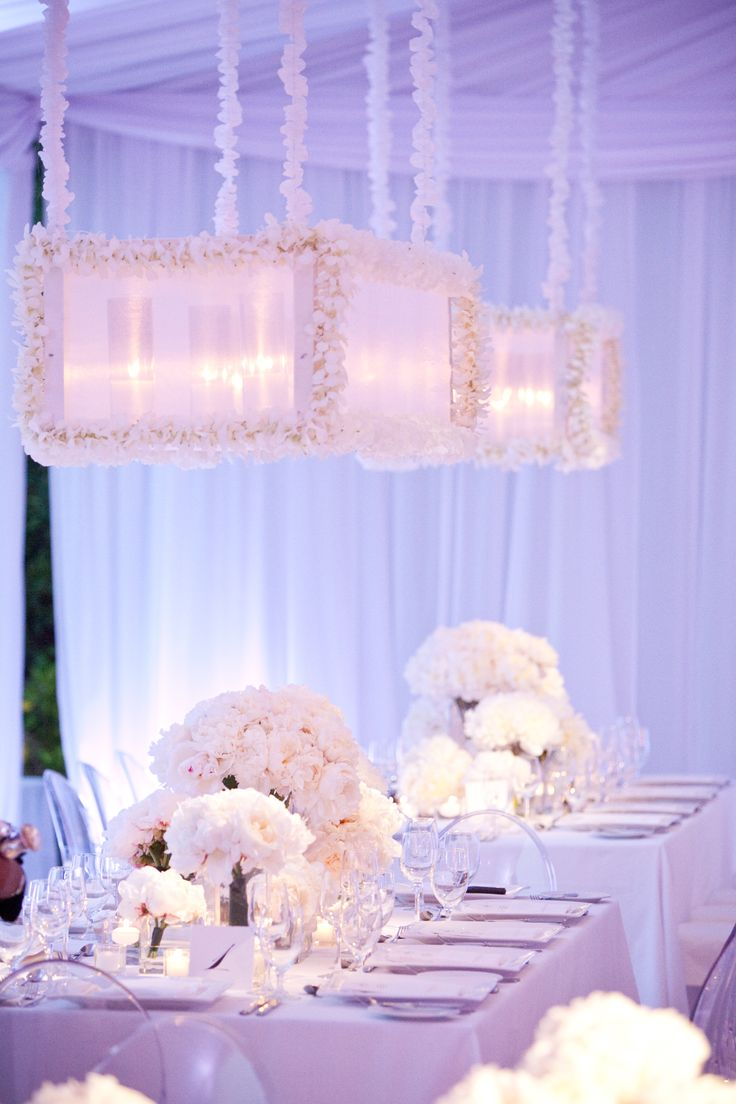 Be on the lookout for elaborate flower installations that hang over reception tables this year.