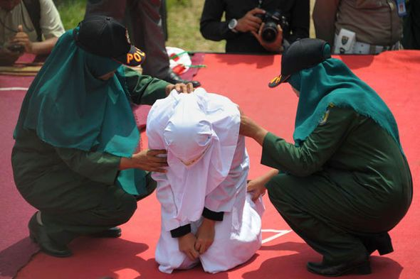 """Two women were publicly caned for getting """"too close"""" to their boyfriends in Aceh last month.   Earlier this year, the local government banned Valentine's Day celebrations, including giving cards or chocolates, deeming it an 'unlawful act' under Sharia.  Banda Aceh has also banned women from entertainment venues after 11pm unless they are accompanied by a husband or male family member."""