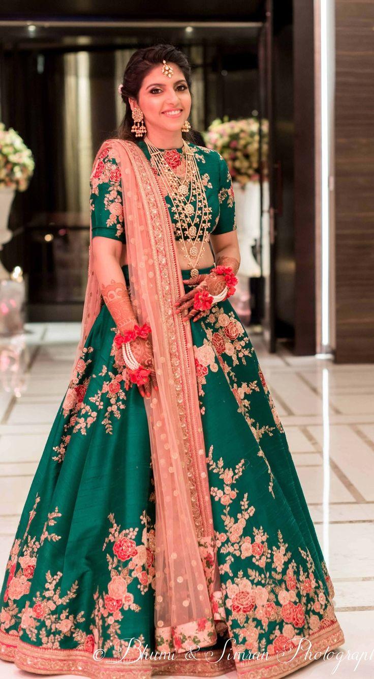 Sangeet Lehengas - Teal Floral Lehenga | WedMeGood | Bride Wearing a Teal Lehenga with a Beige Dupatta and Satlada Haar and Floral Haath Phool #wedmegood #lehenga #indianbride #indianlehenga #indianwedding #teal #beige
