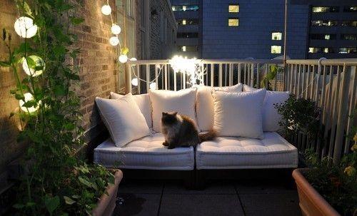 small balcony retreat area. Looks like a cozy place to unwind with a glass of wine
