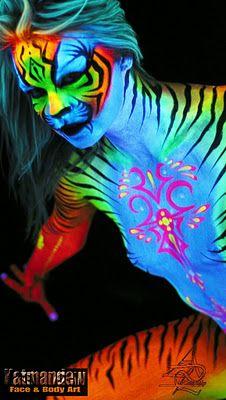 tiger body paint glows under black light.
