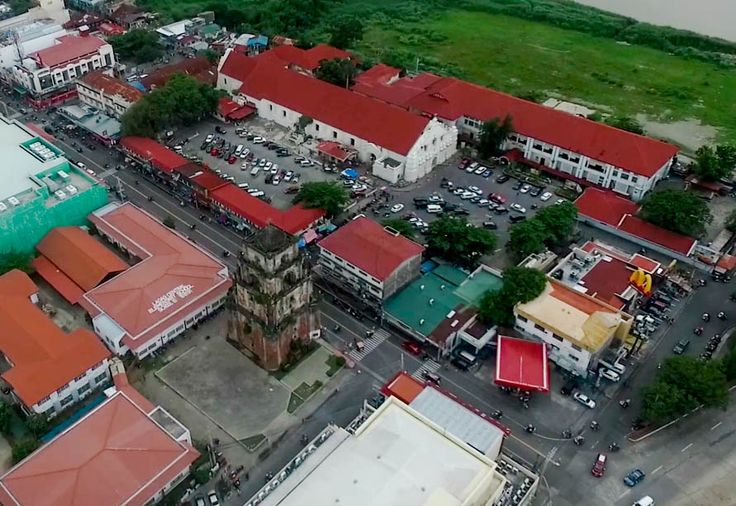 This is a drone image of the Sinking Belltower in the City of Laoag, in Ilocos Norte, Philippines. This landmark is built by the Spanish over 300 years ago, and has been sinking deeper into the ground ever since.