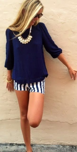 Navy blue lose sweater and white shorts with navy blue stripes Love them!