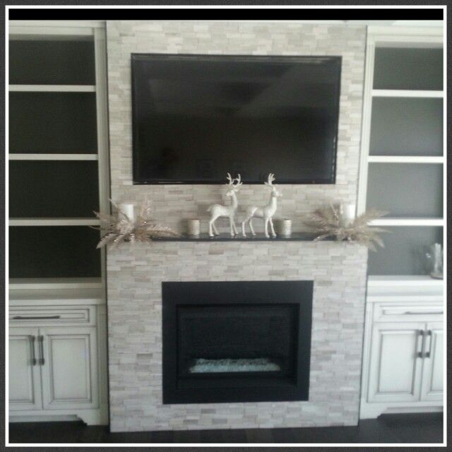 Neutral Mosaic Tile used to create Family Room Fireplace