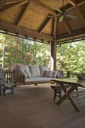 traditional porch by Wright Design.  LOVE that porch swing.  Nicely paired with adirondack chairs!