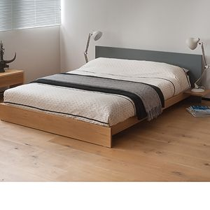 Koo is a stunning, modern low wooden bed. The solid wood bed frame comes with a painted headboard in the colour of your choice. UK Made. Free UK Delivery.