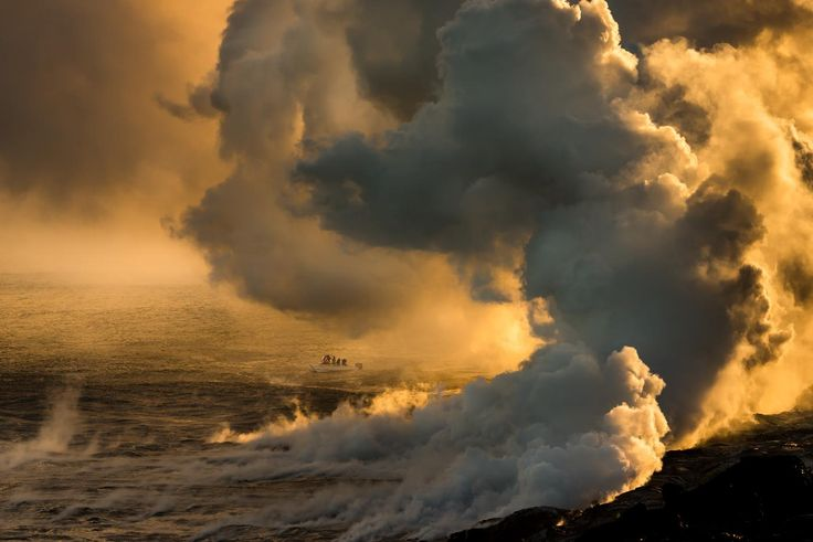 A tiny fishing boat gets close to the lava pouring into the ocean and is surrounded by steam.  Look closely and you may see they are taking pictures.  Do you think they are thinking about light, composition, sharpness, exposure and white balance?  More importantly, did I think my picture through?   ISO 100 165mm  f/8  1/400 sec