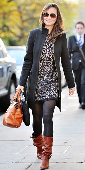 Pippa Middleton rewore her lace H&M dress (last seen in September), and bundled up in a wool coat. Slouchy boots and a Modalu handbag completed her look.