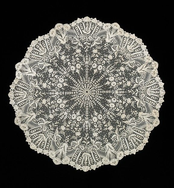 Parasol Cover: 1880-89. Belgian. Made of linen and silk. This lace was put on top of parasol to add a decorative element to the parasols that kept the sun off the face.