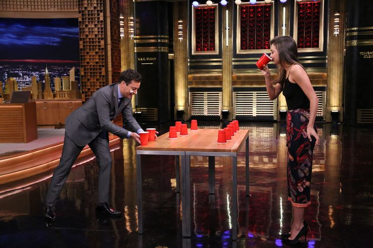 Miranda Kerr gets in on a little flip cup action with Jimmy Fallon during an appearance on 'The Tonight Show'