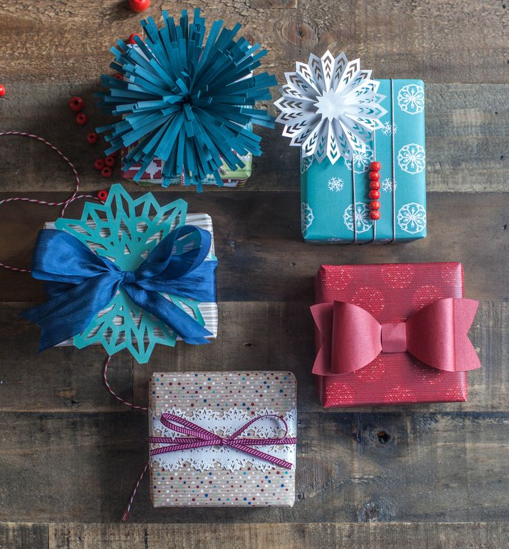 #papercraft #giftwrapping - Pretty holiday gift wrapping by Lia Griffith. Made with the Cricut Explore and Pretty Packages Cricut image set