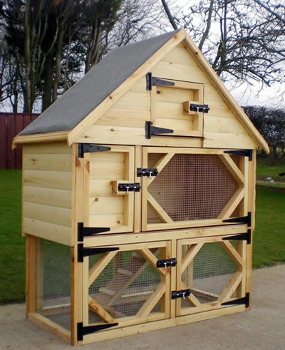 Single Deluxe Rabbit Hutch with Open Bottom Run and Food Storage in Log Lap. Rabbit Hutch number 9.