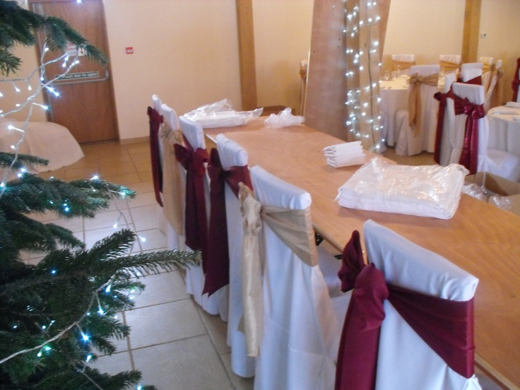 Alternating Matt Burgundy and Champagne Satin Side Bows on White Chair Covers