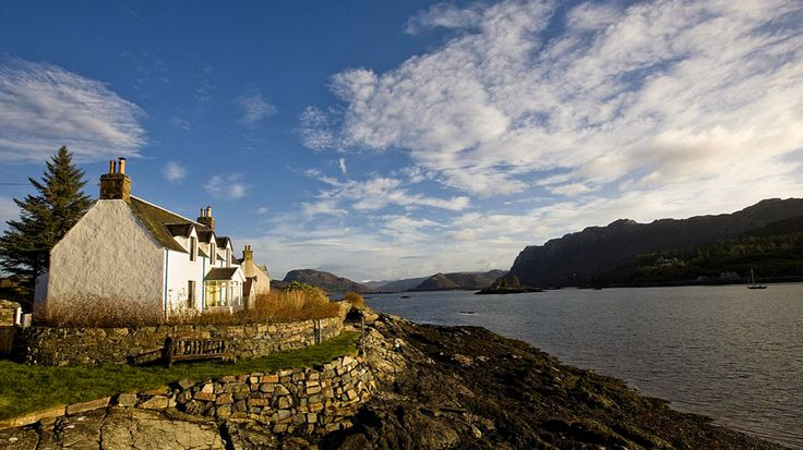Plockton, Scotland  ~  Seaside Cottage  ~  Though this settlement lies in the Scottish Highlands, you'd be better equipped with a pair of hiking shorts than a kilt. After traipsing around Loch Carron, trek through the woodlands for a view of Duncraig Castle, a private mansion with 80 plus rooms that sits on more than 40 acres of countryside.