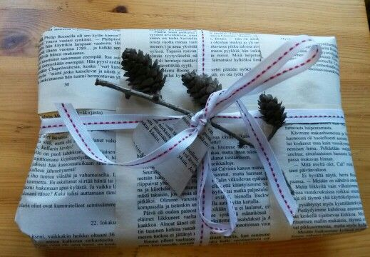 Giftwrap  I used pages from old book and twig with cones