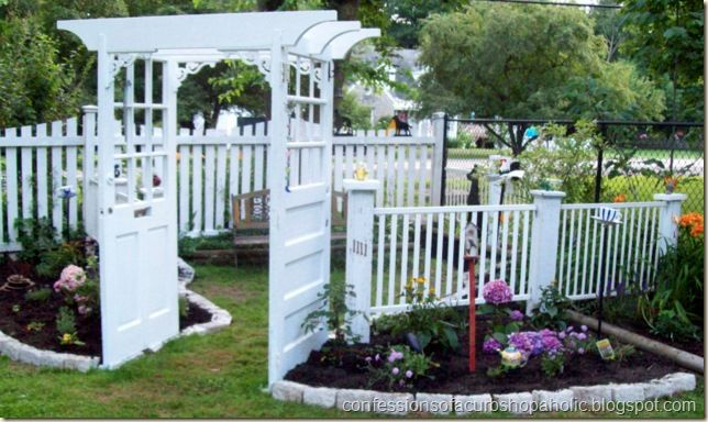 I would LOVE a yard like this. She used old doors, arbor, and salvaged wood to create a haven to sit and reflect. They buried their long time pet under a tree inside the fenced area. <3