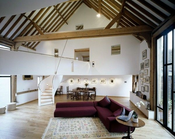 I love the contrast of the wood against the white on the ceiling.  And the general open floor plan