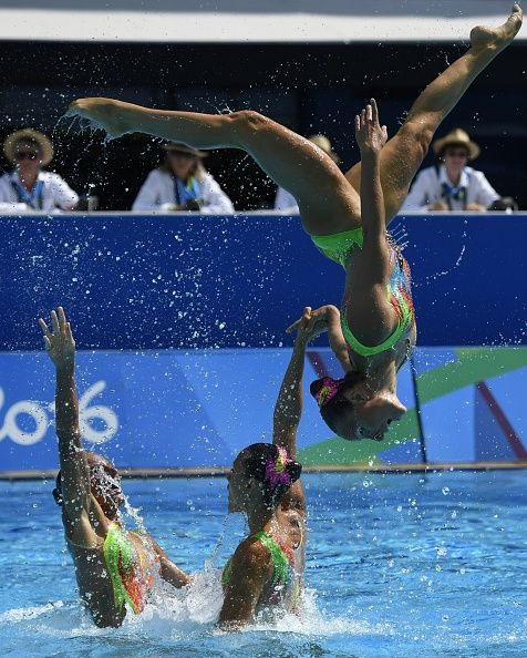 Team Italy competes in the Teams Free Routine final during the synchronised…