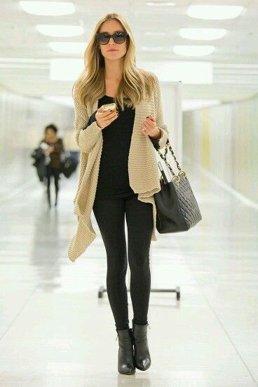 Simple and stylish: sleek black top, skinny black pants, black ankle booties topped with a chunky camel cardigan