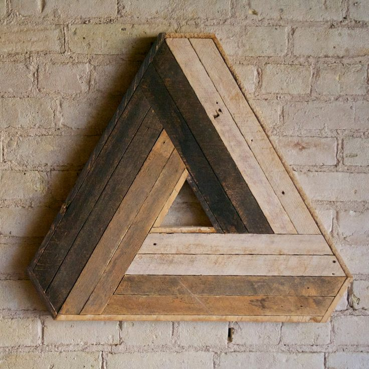 Handmade Penrose triangle made out of reclaimed lath wood. This wood is salvaged from the ceiling of my art studio and has been reimagined into a classic impossible design made famous by M. C. Escher.  24.5w x 22h x 1.5d  Made to order.  Can be customized.  This design is copyright protected. Created by Eleventy One Studio