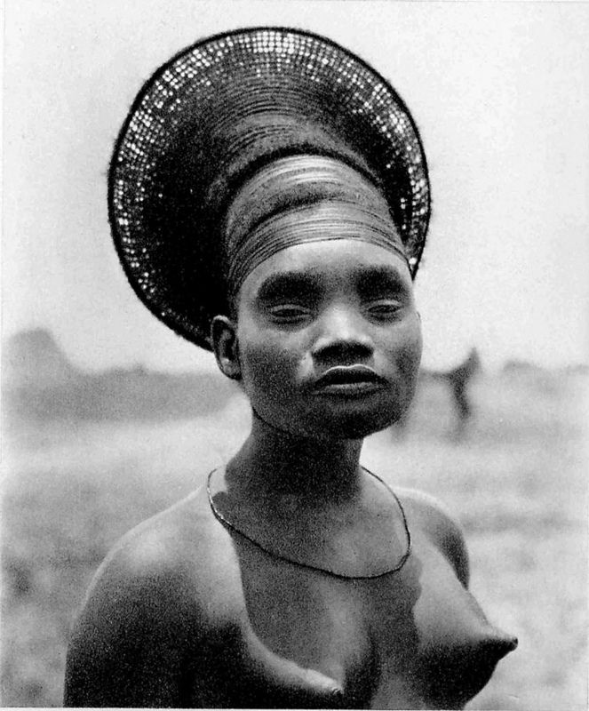 Skull deformation by the Mangbetus. ´Mrs Nobosodrou, wife of a Mangbetu chief, Belgian Congo. Photographer: Leon Poirier and George Specht during the French Citroen Expedition through Africa, March 1925.