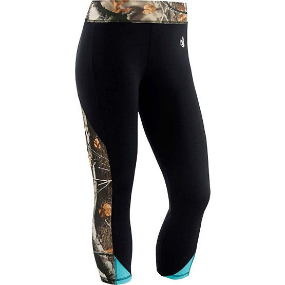 """Now you can take some camo along to keep you looking your best during a workout. These poly/spandex fitness Capri's feature just a bit of Big Game® Camo accenting and a reflective Signature Buck. The unique zippered back waistline pocket with 4"""" opening works great for iPods, keys, or credit cards. The 4 way stretch fabric has anti microbial and moisture management finish to help keep you fresh, dry and comfortable. Inseam measures 20 1/2"""" to 21 3/4""""."""