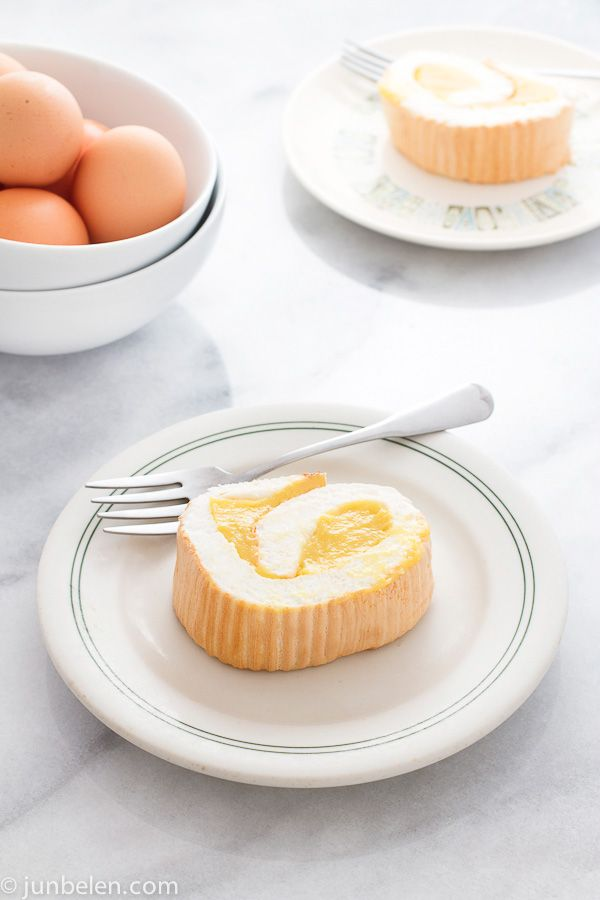 """The ambrosial Brazo de Mercedes — pillowy meringue rolled and filled with thick, rich custard.  Brazo, as I fondly call it, is truly decadent. A sheet of meringue topped with smooth custard is rolled like a jelly roll into a log or """"brazo"""" (Spanish for arm) and then sliced and served with coffee or tea."""