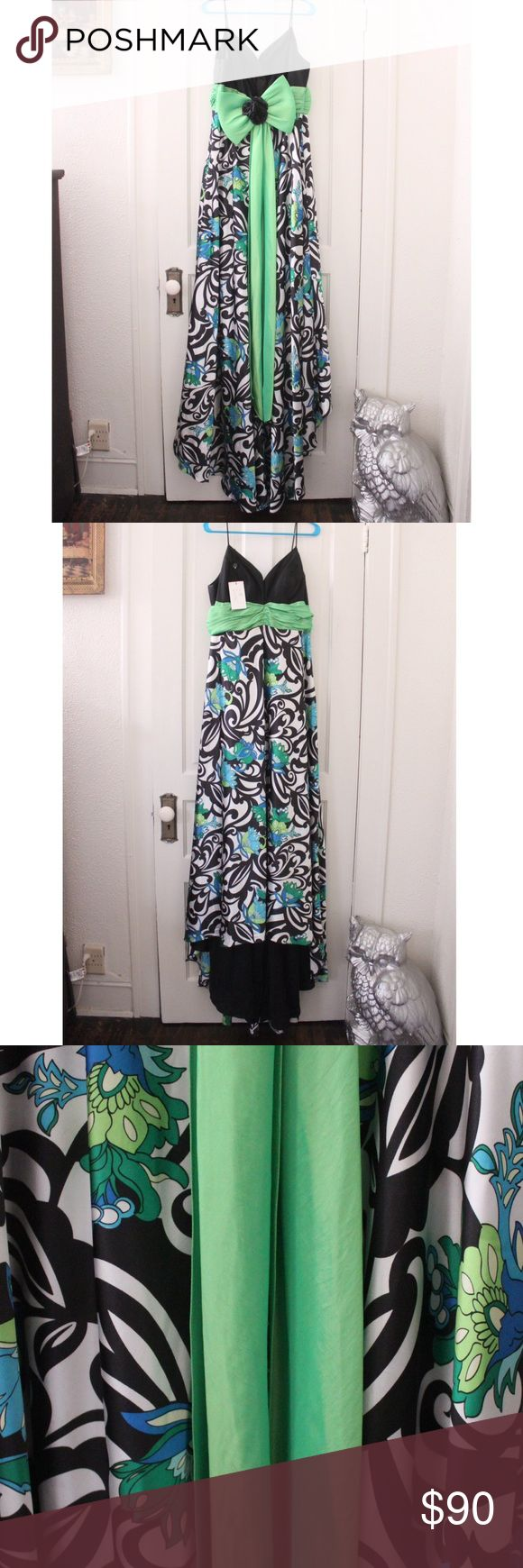 Jovani patterned prom dress w/ blue floral detail. Jovani formal/prom dress. Black and white pattern with blue and green floral detail. Stunning green bow back accent. Size 22, worn once. Jovani Dresses Prom