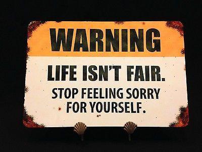 "If you like tough love and hate complainers; this beautiful, richly colored metal sign was made for you! Featuring a distressed background, this sign reads, ""Warning: Life Isn't Fair. Stop feeling sor"