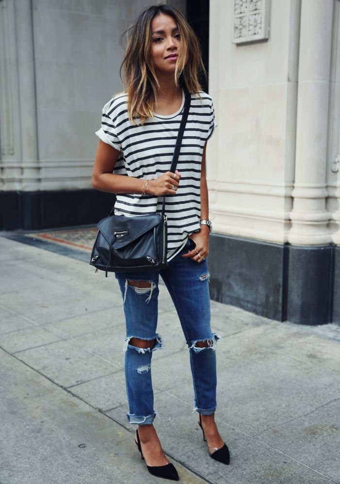 short-sleeved black and white striped shirt, medium wash boyfriend jeans, black heels, crossbody small black purse