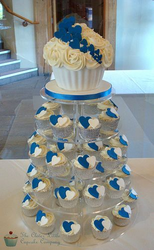 Cobalt Blue Wedding Tower  It would be nice to have sugar cookies decorated like these cupcakes.