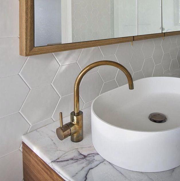 •BATHROOM SPLASHBACK/BENCHTOP• Hexagon tiles from Tile Boutique. Marble benchtop. Brass accessories.
