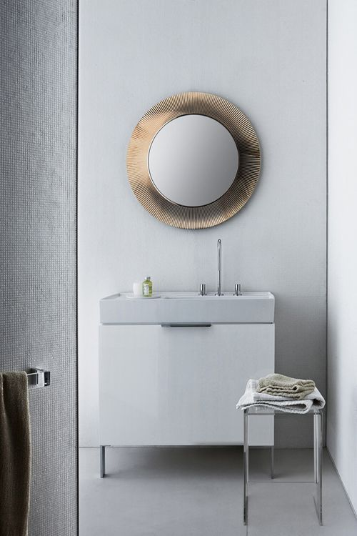 Top Tip: For small bathrooms, use large mirrors to reflect the light and visually increase the space.