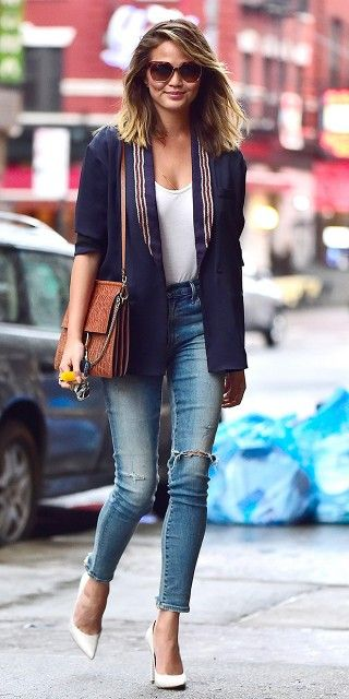 Chrissy Teigen Looks Effortlessly Polished in Distressed Denim via @WhoWhatWear blazer navy jeans white pumps sunglasses date night outfit happy hour night out attire casual