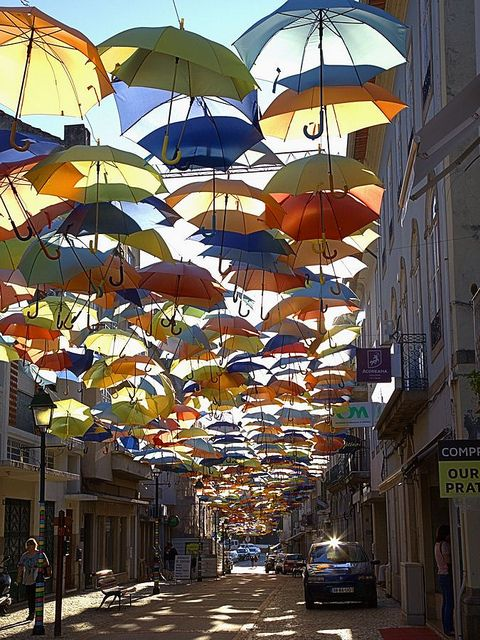 The Umbrella Street by Alfonso Chaby: Águeda, Portugal #Installation #Umbrellas #Portugal