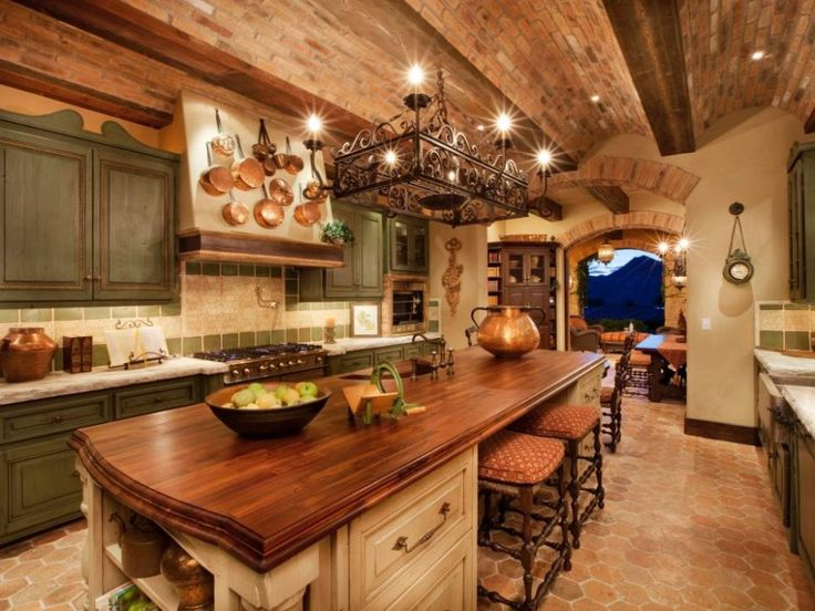 Design Ideas: Warm Kitchen With Italian Inspired Design. ceiling design. warm kitchen. brick exposed ceiling. curved ceiling. bronze finished pendant light. hardwood countertop. green kitchen cabinet. honeycomb flooring.